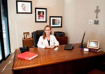 ashly cothern dds sitting at desk