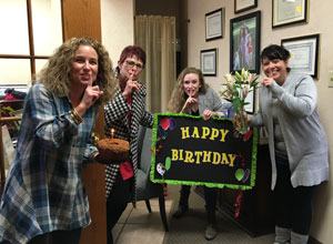 ashly cothern team with happy birthday sign
